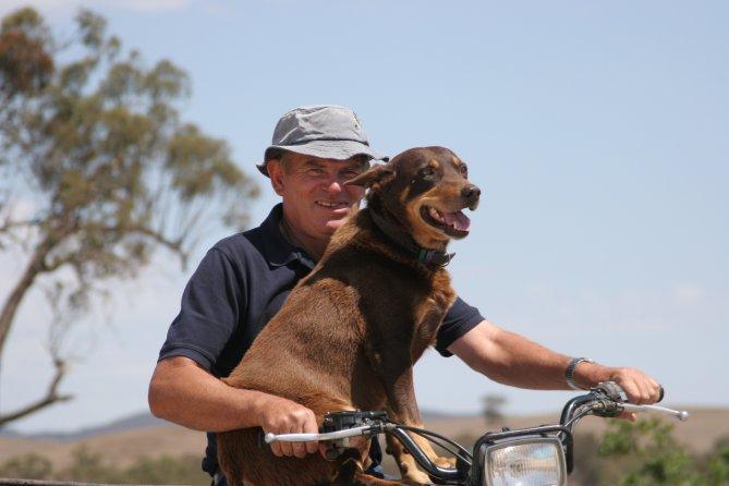 Farmer with dog on bike