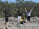 J students on rocks